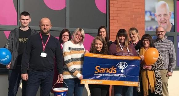 Payzone employees with Sands banner